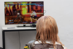 Unidentified teenager playing console games at Animefest Stock Images