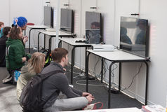 Unidentified teenagers playing console games at Animefest Stock Image