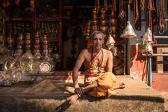 Unidentified temple brahmin sitting in his shop in Gokarna Royalty Free Stock Photos
