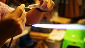 Unidentified Thai artist in blowing glass activity.  stock footage