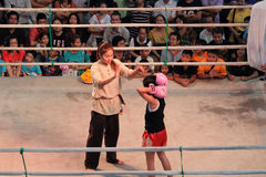 Unidentified Thai boxing referee count down to a boxing girl Royalty Free Stock Photos