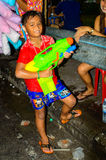 An unidentified thai boy joins Thai new year celebrations or Songkran Day. Stock Photos