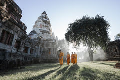 Unidentified Thai monks walking at Phanomwan Historical Park Royalty Free Stock Image