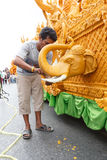 Unidentified thai people candle Carver   on the traditional candle procession festival of Buddha Stock Photo