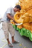 Unidentified thai people candle Carver   on the traditional candle procession festival of Buddha Royalty Free Stock Image
