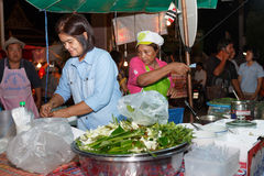 An unidentified Thai people sells food on night market wall street. Stock Image