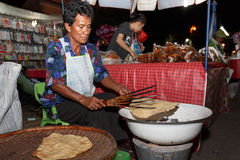 An unidentified Thai people sells food on night market wall street. Stock Photo