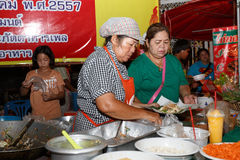 An unidentified Thai people sells pad thai on night market wall street. Stock Photo