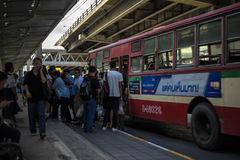 Unidentified thai people waiting at the bus stop in Bangkok. Bangkok, Thailand - November 19, 2016: Unidentified thai people waiting at the bus stop in Bangkok Stock Image