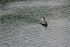 Unidentified three men are fishing Royalty Free Stock Photography