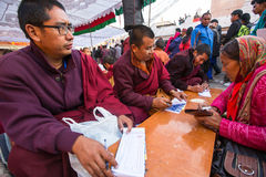 Unidentified tibetan Buddhist monks during festive Puja of H.H. Drubwang Padma Norbu Rinpoche's reincarnations. KHATMANDU, NEPAL - DEC 15: Unidentified tibetan Royalty Free Stock Photos