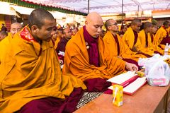 Unidentified tibetan Buddhist monks near stupa Boudhanath during festive Puja of H.H. Drubwang Padma Norbu Rinpoche's reincarnatio Royalty Free Stock Photo