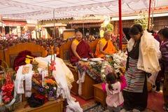 Unidentified tibetan Buddhist monks near stupa Boudhanath during festive Puja of H.H. Drubwang Padma Norbu Rinpoche's reincarnatio. KHATMANDU, NEPAL - DEC 17 Royalty Free Stock Photography
