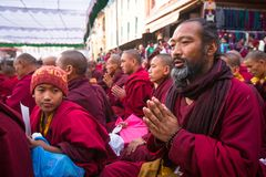 Unidentified tibetan Buddhist monks near stupa Boudhanath during festive  Puja. Royalty Free Stock Image