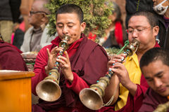 Unidentified tibetan Buddhist monks near stupa Boudhanath during festive Puja Stock Images