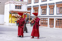 Unidentified tibetan buddhist monks play music for opening ceremony of the Hemis Festival Royalty Free Stock Images