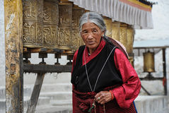 Unidentified Tibetan pilgrim circles the Potala palace Royalty Free Stock Photos