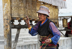 Unidentified Tibetan pilgrim circles the Potala palace Stock Images