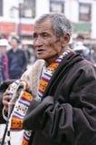 Unidentified Tibetan pilgrim circles the Potala palace Stock Photography