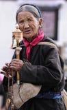 Unidentified Tibetan pilgrim circles the Potala palace Stock Photos