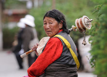 Unidentified Tibetan pilgrim circles the Potala palace Royalty Free Stock Image