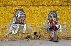 Unidentified Tibetan pilgrim circles the Potala palace Royalty Free Stock Photo