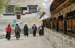 Unidentified Tibetan pilgrims circle the Gyantse monastery Royalty Free Stock Photography