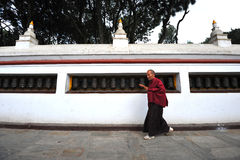 Unidentified Tibetan pilgrims turn the prayer wheels Stock Photography