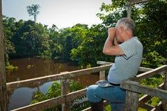 Unidentified tourist with binoculars, Yasuni Stock Images