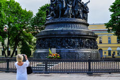 Unidentified tourist girl takes the shot of the monument Millennium of Russia, Veliky Novgorod, Russia Stock Images