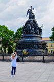 Unidentified tourist girl takes the shot of the monument Millennium of Russia, Veliky Novgorod, Russia Stock Photos