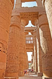 Unidentified tourist near columns of the Great Hypostyle Hall at the Temples of Karnak, Egypt Stock Images