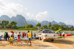 Unidentified tourist preapre travel by boat. VANG VIENG, LAOS - OCT 18: unidentified tourist preapre travel by boat on oct 18, 2015, in Vang Vieng, Laos. Vang Royalty Free Stock Image