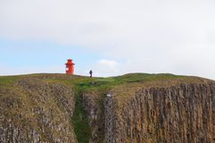 Unidentified tourist walking down from the cliff in Stykkisholmur,Iceland. Stock Photos