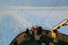 Unidentified tourists aboard the arctic Icebreaker Sampo during unique cruise in frozen Baltic Sea. Stock Photos