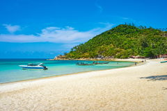 Unidentified tourists and boats at Koh Phangan island Beach. Thailand. Stock Photos