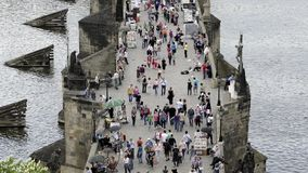 Unidentified tourists on Charles Bridge (Karluv Most) in afternoon, a famous historic bridge in Prague. PRAGUE, CZECH REPUBLIC -SUMMER 2015: Unidentified stock video