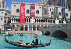 Unidentified tourists enjoy gondola ride at Grand Canal at The Venetian Resort Hotel Casino Stock Image
