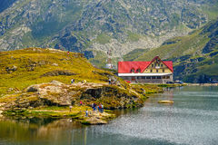 Unidentified tourists enjoy the sights of Balea Lake at 2,034 m altitude in Fagaras Mountains Stock Photography