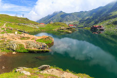 Unidentified tourists enjoy the sights of Balea Lake at 2,034 m altitude on July 21 Stock Photo