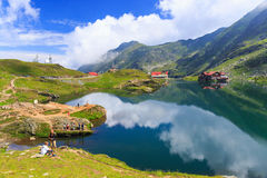 Unidentified tourists enjoy the sights of Balea Lake at 2,034 m altitude on July 21 Stock Image