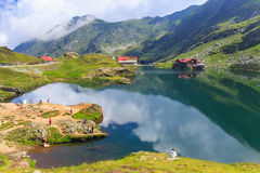 Unidentified tourists enjoy the sights of Balea Lake at 2,034 m altitude Royalty Free Stock Photography