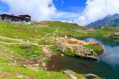 Unidentified tourists enjoy the sights of Balea Lake at 2,034 m altitude Royalty Free Stock Photos