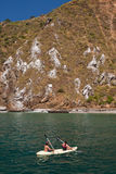 Unidentified tourists enjoying a daytrip kayaking Royalty Free Stock Images