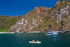 Unidentified tourists enjoying a daytrip kayaking Royalty Free Stock Photo