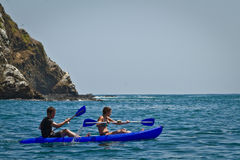 Unidentified tourists enjoying a daytrip kayaking Stock Image