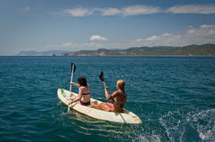 Unidentified tourists enjoying a daytrip kayaking. MANABI, ECUADOR - JUNE 4, 2012: Unidentified tourists enjoying a daytrip kayaking in beautiful paradise beach Stock Images