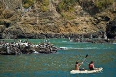 Unidentified tourists enjoying a daytrip kayaking Stock Photos