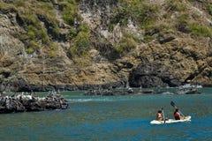 Unidentified tourists enjoying a daytrip kayaking. MANABI, ECUADOR - JUNE 3, 2012: Unidentified tourists enjoying a daytrip kayak ingin beautiful paradise beach Stock Photo