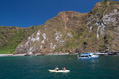 Unidentified tourists enjoying a daytrip. MANABI, ECUADOR - JUNE 4, 2012: Unidentified tourists enjoying a daytrip snorkeling in beautiful paradise beach in Stock Photography